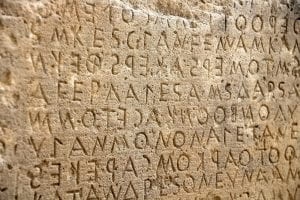 Latin characters inscribed in stone