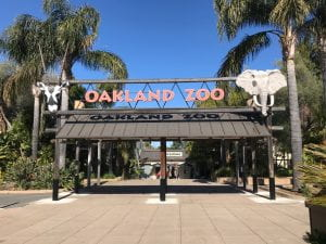 Entrance of the Oakland Zoo with an ibex head to the left and african elephant head to the right