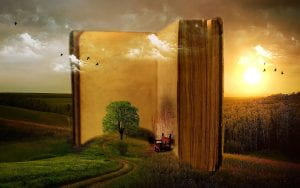 Book with tree, clouds, and birds coming out of it